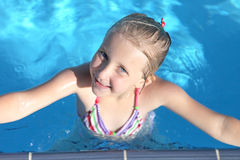 Girl in swimming pool. Summer day Royalty Free Stock Images