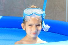 Girl in the swimming pool. Girl with mask in the swimming pool Royalty Free Stock Photography