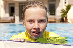 Girl in a swimming pool Stock Photography