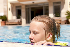 Girl in a swimming pool Royalty Free Stock Photos