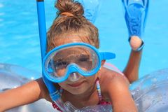 Girl in the swimming pool. With diving mask Stock Photo