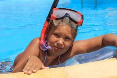 Girl in the swimming pool. With diving mask Stock Photography