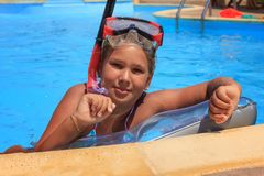 Girl in the swimming pool. With diving mask Stock Images
