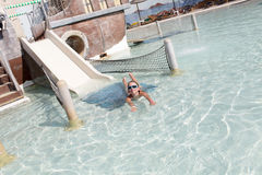 Girl swimming in pool. Girl is swimming in a pool at water park Royalty Free Stock Photo