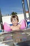 Girl in swimming pool Stock Image