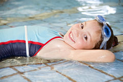 Girl in swimming pool. Girl lying down in a swimming pool Stock Photography