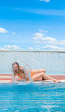 Girl on the swimming pool. Girl relaxing on the swimming pool Royalty Free Stock Photo