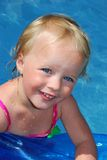 Girl in the swimming pool. Stock Photos