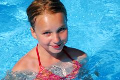 Girl in a swimming pool. Young girl in a swimming pool Royalty Free Stock Photography
