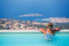 Girl at swimming pool Stock Photos