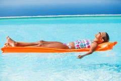 Girl at swimming pool Royalty Free Stock Image