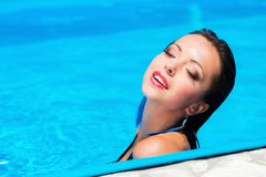 Girl in swimming pool Stock Photos