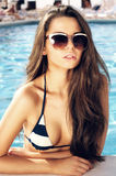 Girl in swimming pool. Closeup fashion portrait of sexy girl standing in swimming pool Stock Photo