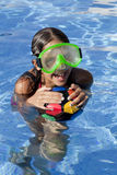 Girl is the swimming pool with color ball Royalty Free Stock Images