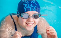 Girl in the Swimming Pool Royalty Free Stock Photography
