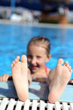Girl swimming in the pool for a long time. Girl bathing pool for very long Royalty Free Stock Image