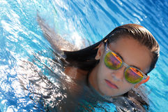 Girl swimming in pool Royalty Free Stock Photos