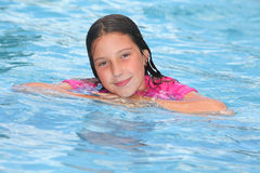 Girl in a swimming pool. Portrait of a girl in a swimming pool royalty free stock photo