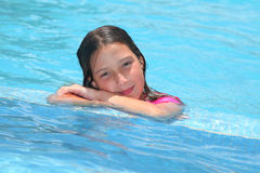 Girl in a swimming pool. Portrait of a girl in a swimming pool stock photography