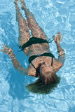 Girl in swimming pool - Relaxation Stock Photo