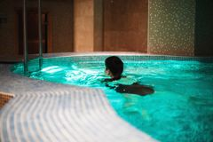 The girl is swimming in the pool. royalty free stock photo
