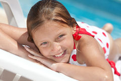 Girl by the swimming pool. Smiling little girl by the swimming pool Stock Images