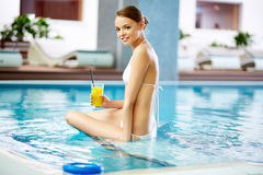 Girl in swimming pool. Girl spending time in pool Royalty Free Stock Photos