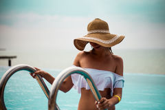 Girl going out from swimming pool with Black sea view, sunset royalty free stock images