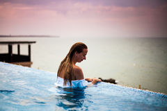 Woman in a swimming pool with Black sea view, sunrise Stock Photos