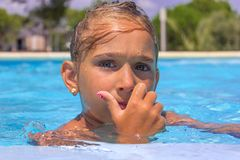 Girl in the swimming pool Stock Image