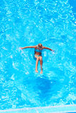 Girl swimming in pool Royalty Free Stock Photo