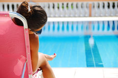 Girl by the swimming pool Stock Photo
