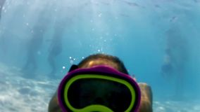 Girl in the swimming pool, underwater stock video