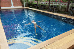 Girl in swimming pool. 8 years old girl playing in swimming pool at hotel Stock Photography