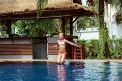 Girl in swimming pool. 8 years old girl playing in swimming pool at hotel Stock Photo
