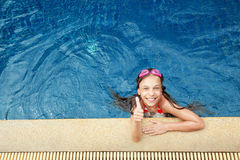 Girl in swimming pool Royalty Free Stock Photos