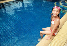 Girl in swimming pool. 8 years old girl playing in swimming pool at hotel Stock Image