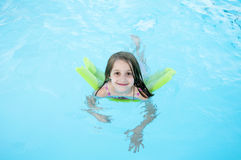 Child swimming in pool Stock Photos