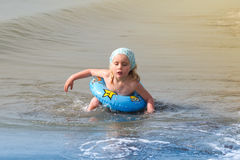 Girl with swimming ring. Little girl with swimming ring in the water Royalty Free Stock Photos