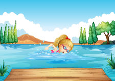 A girl swimming in the river Stock Photo