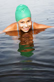 Girl swimming in sea Stock Photos