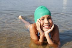 Girl swimming in sea Stock Images