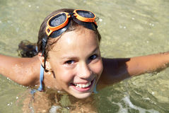 Girl swimming in sea Royalty Free Stock Image
