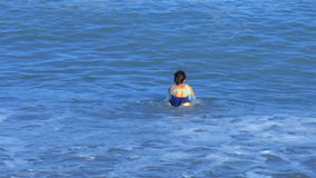 Girl swimming in the sea stock video