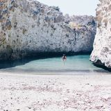 Girl Swimming in Papafragas beach, Milos Island, Greece royalty free stock photography