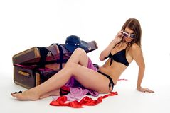 Girl in swimming suit with suitcase Royalty Free Stock Images