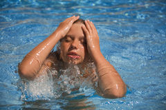Girl swimming in the swimming pool stock photos