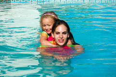 Girl swimming with toddler Royalty Free Stock Photo
