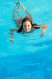 Girl Swimming Underwater Royalty Free Stock Photo