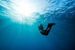 Girl swimming underwater Stock Photo